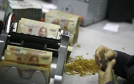 Có nên áp trần lãi suất cho vay ngân hàng quốc doanh?