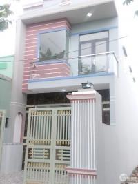 nhà chính chủ cần tiền nên bán căn nhà mới xây DT 100m2 SHR nhà như hình