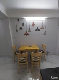 Cần tiền nên bán gấn nhà Nơ Trang Long 4 lầu, HXH, 5 PN.