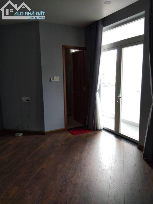 Nhà mới hẻm xe hơi Đường Ba Tháng Hai, 1 trệt 5 lầu thang máy, 4pn 5wc, diện tích 7x14m